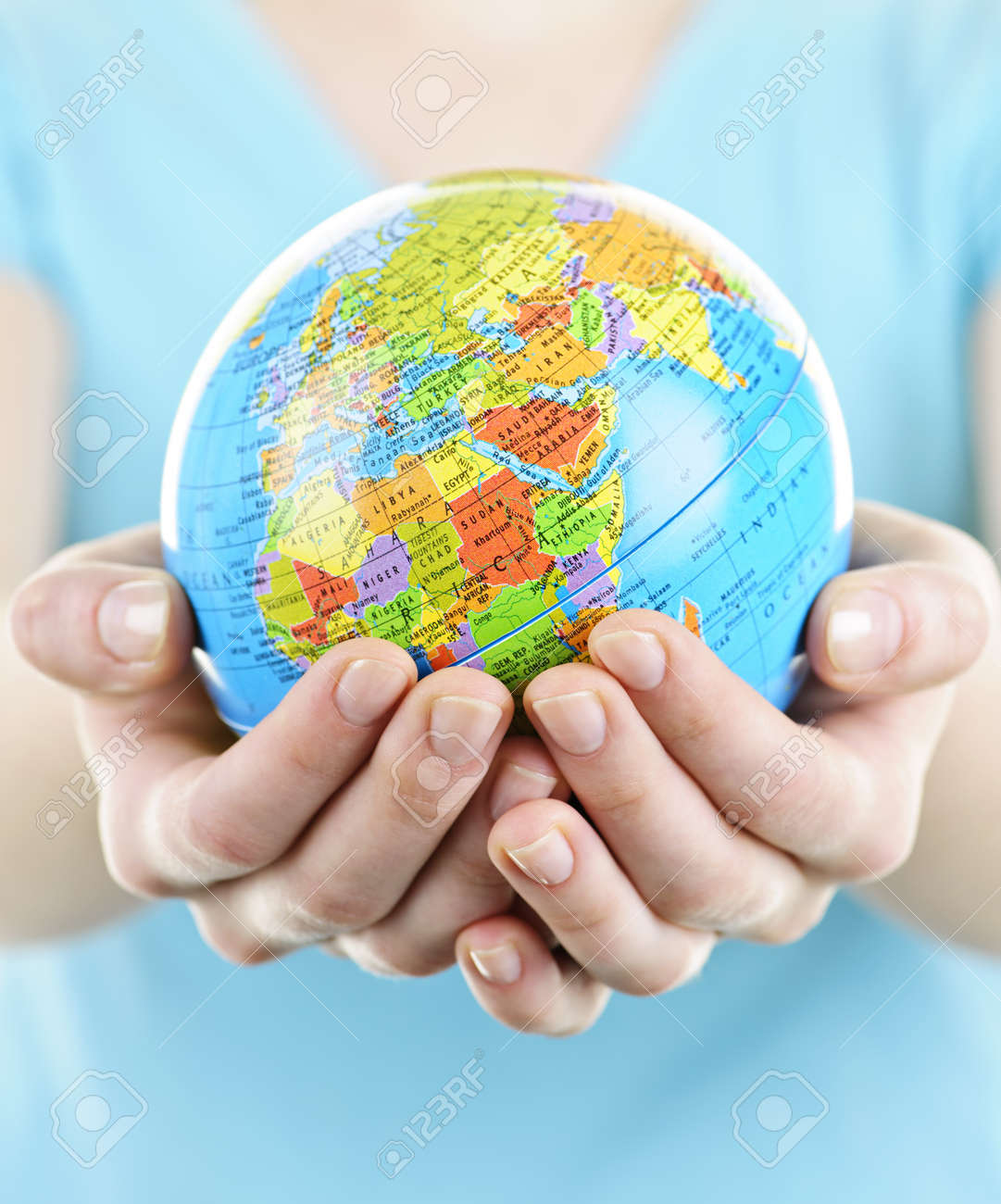 Globe of the planet Earth held in young female hands Stock Photo - 9865725