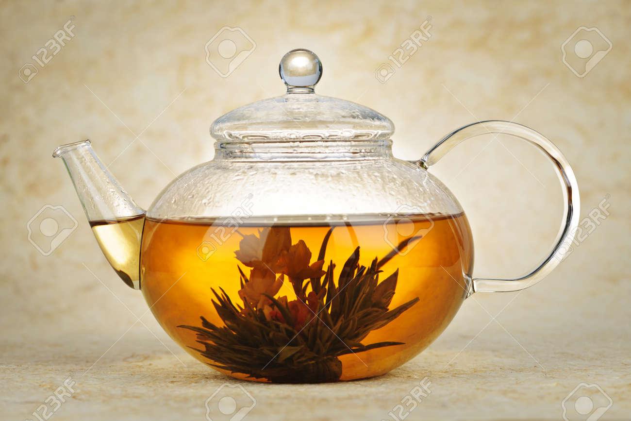 Chinese flower tea - Flowering Blooming Green Tea In Glass Teapot Stock Photo 10009877