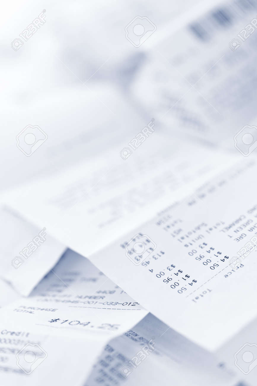 Paper cash register receipts in a lose pile close up Stock Photo - 10500869
