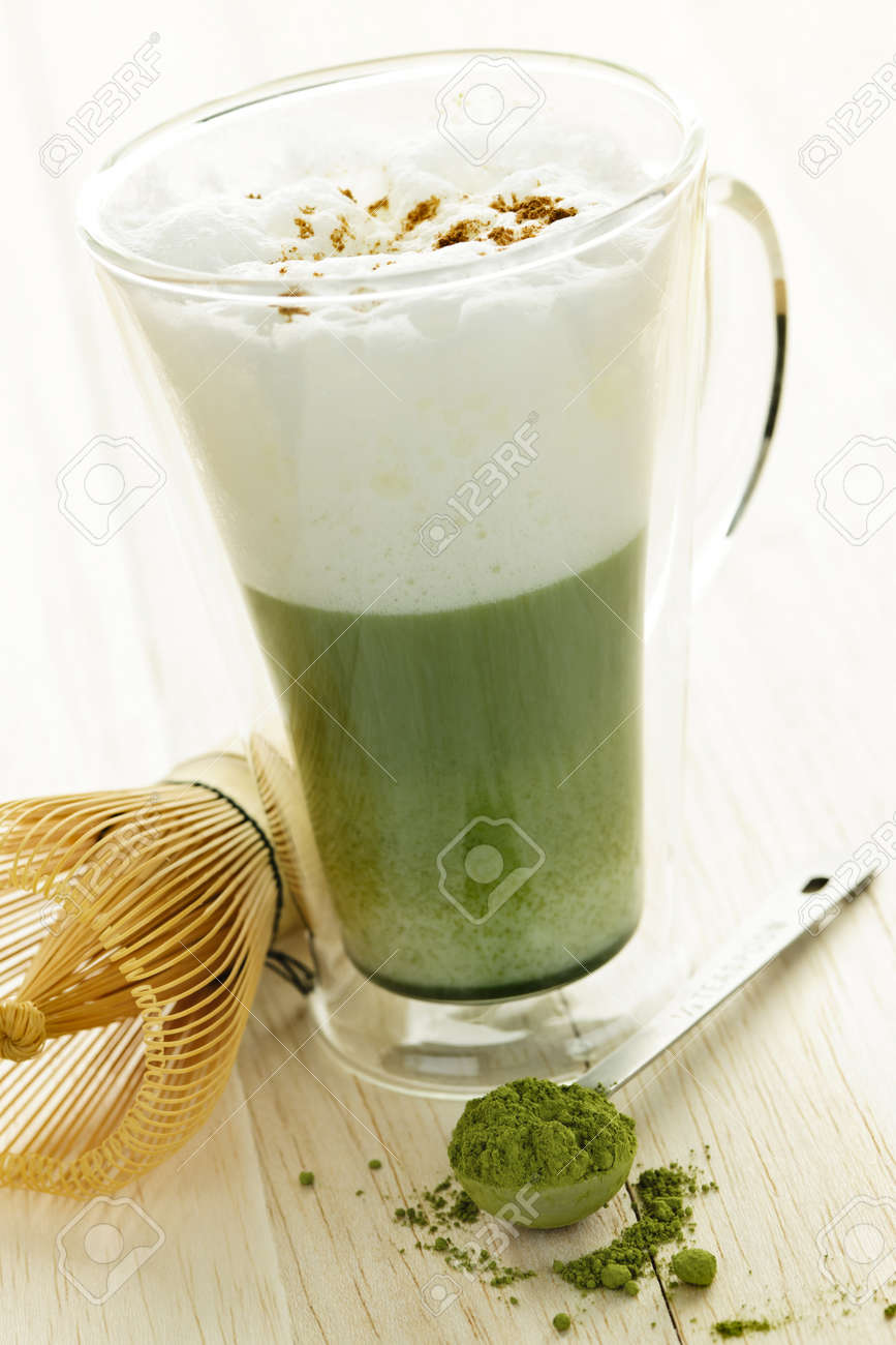 Matcha green tea latte beverage in glass mug with whisk Stock Photo - 10637539