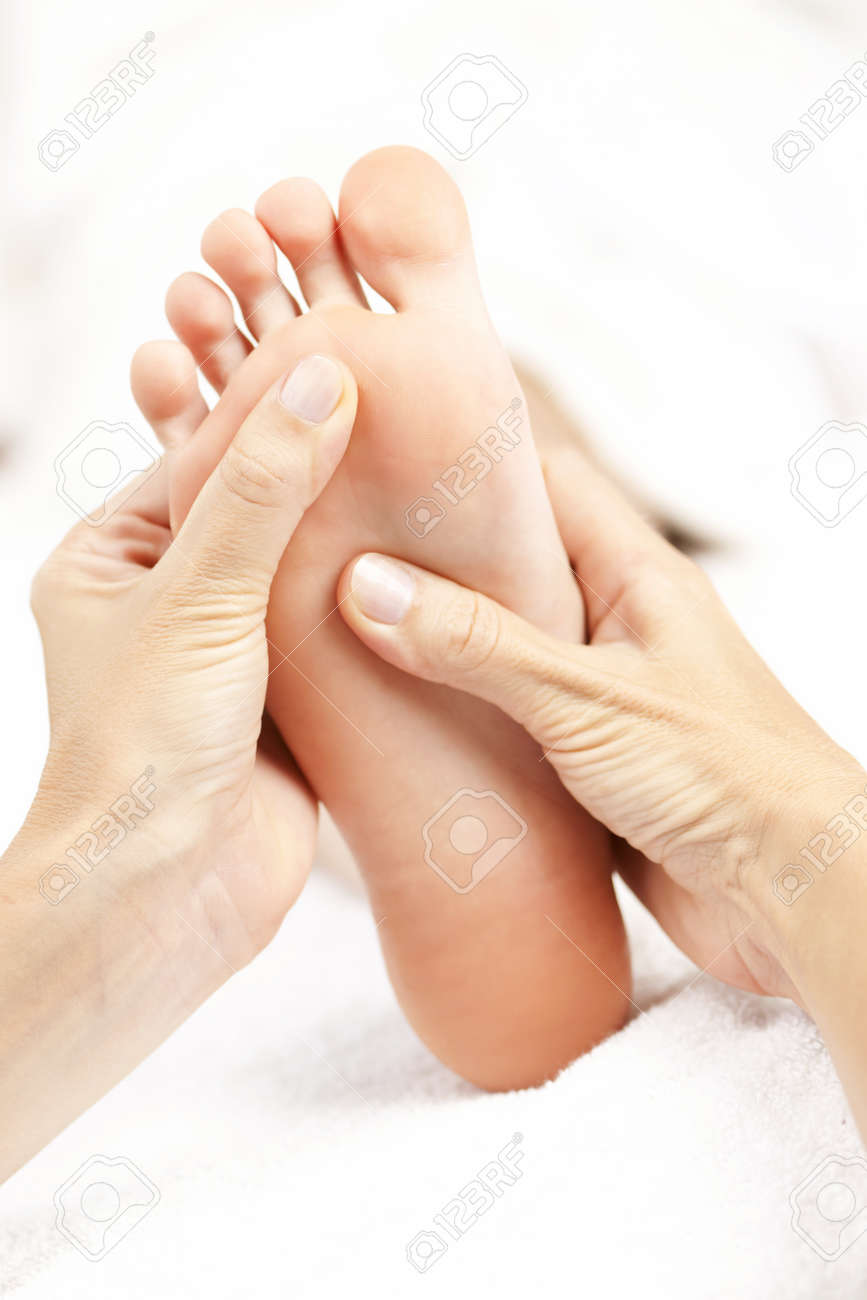 Female hands giving massage to soft bare foot Stock Photo - 10637508