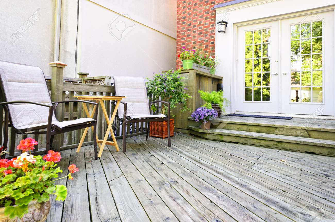 Stock Photo - Wooden deck on house with chairs and french doors & Wooden Deck On House With Chairs And French Doors Stock Photo ...
