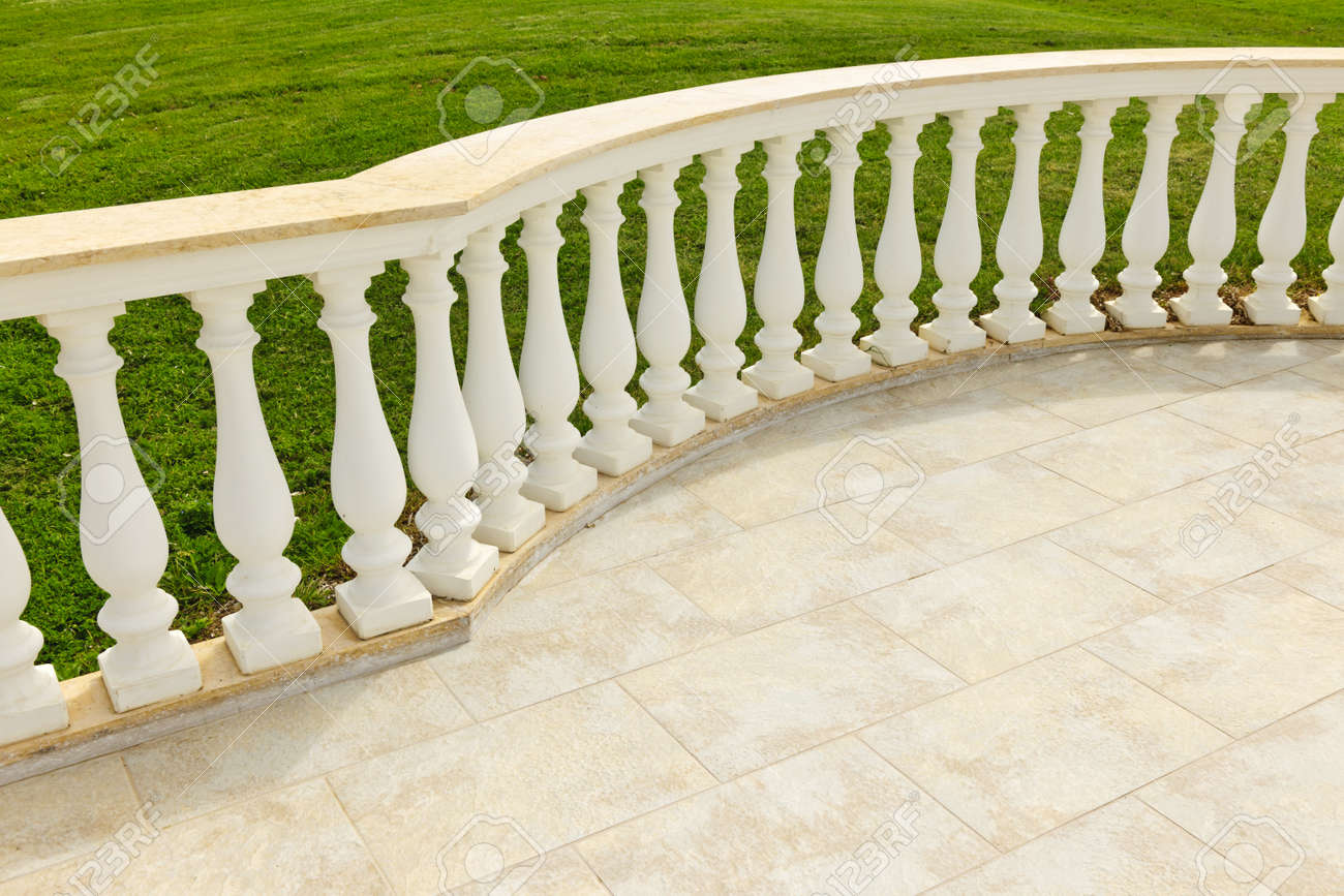Fancy Marble Railing On Ceramic Tile Patio With Lawn Stock Photo   10943433