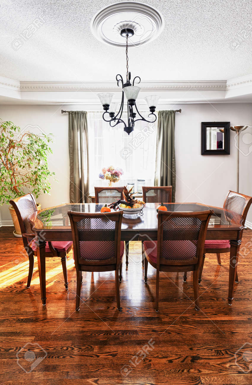 Dining room interior with wooden table and chairs in house Stock Photo - 11372136