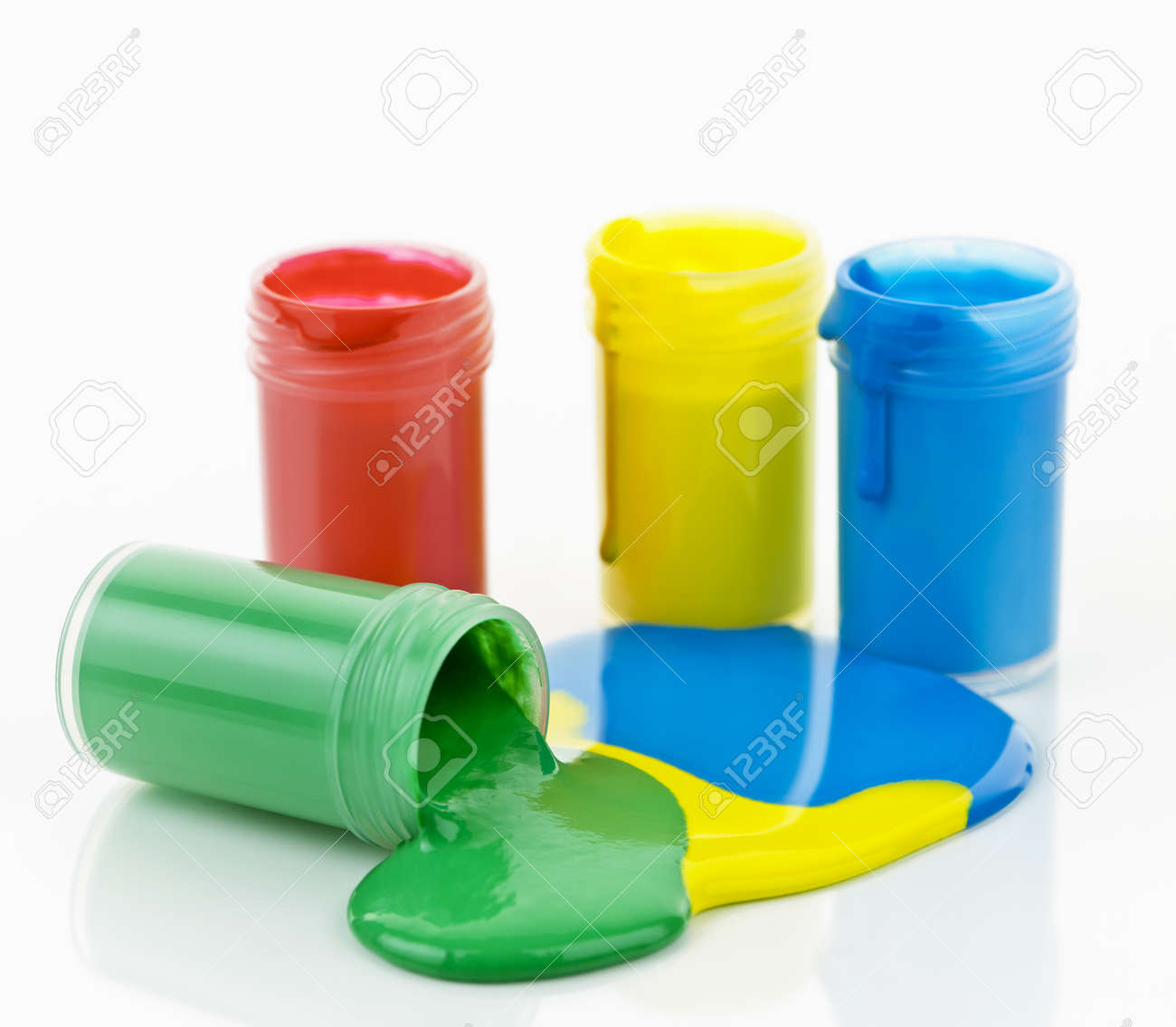 Open containers of paint in primary colors spilled and mixed Stock Photo - 12389842