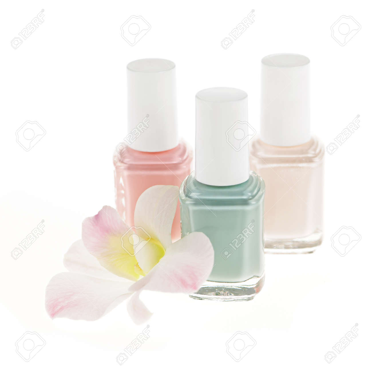 Three nail polish bottles with orchid flower on white background Stock Photo - 13306519