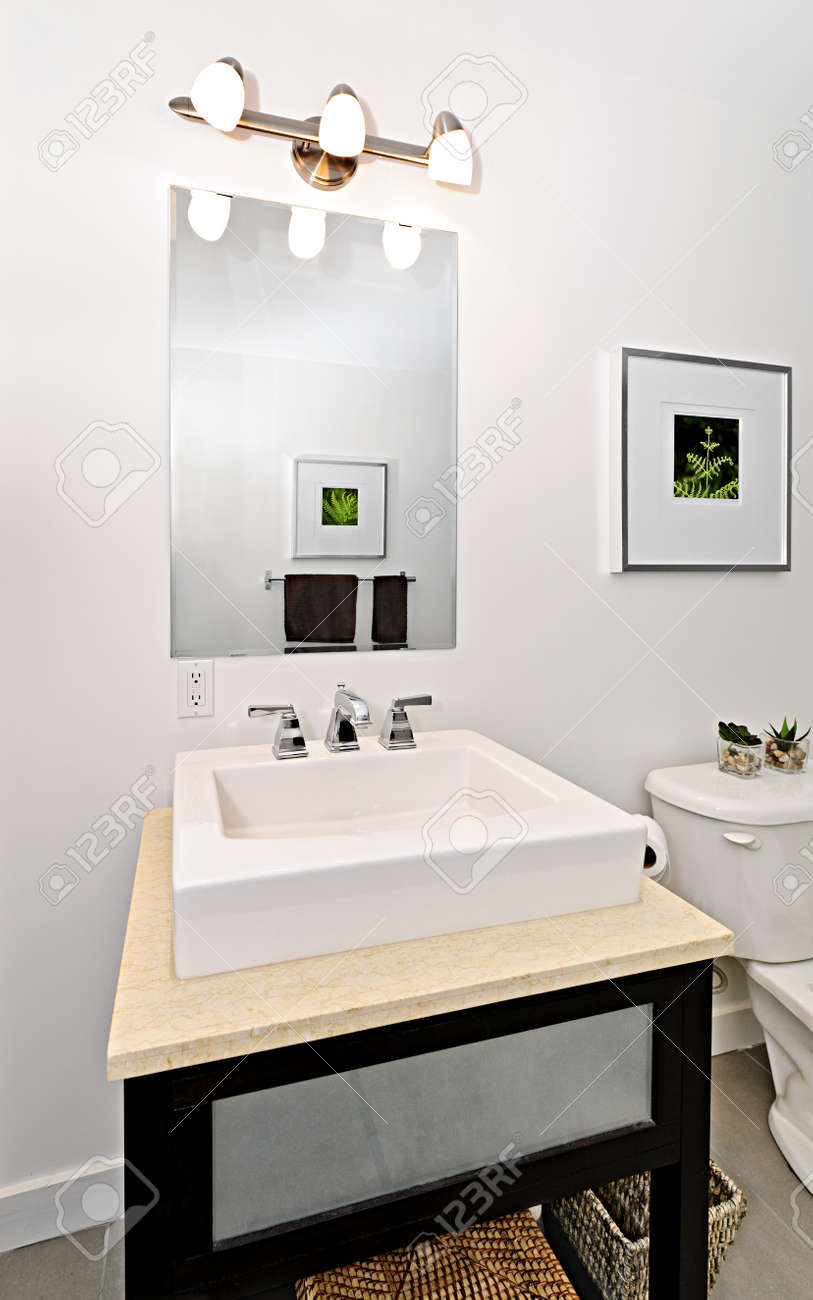 Interior bathroom vanity and mirror - artwork on walls are from photographer portfolio Stock Photo - 15374772