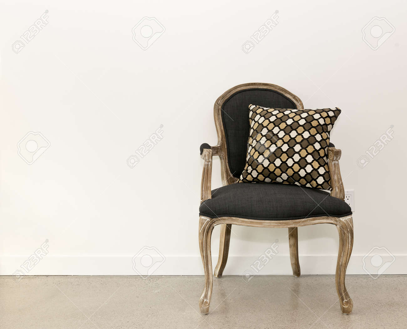 photo antique armchair furniture with cushion against white wall