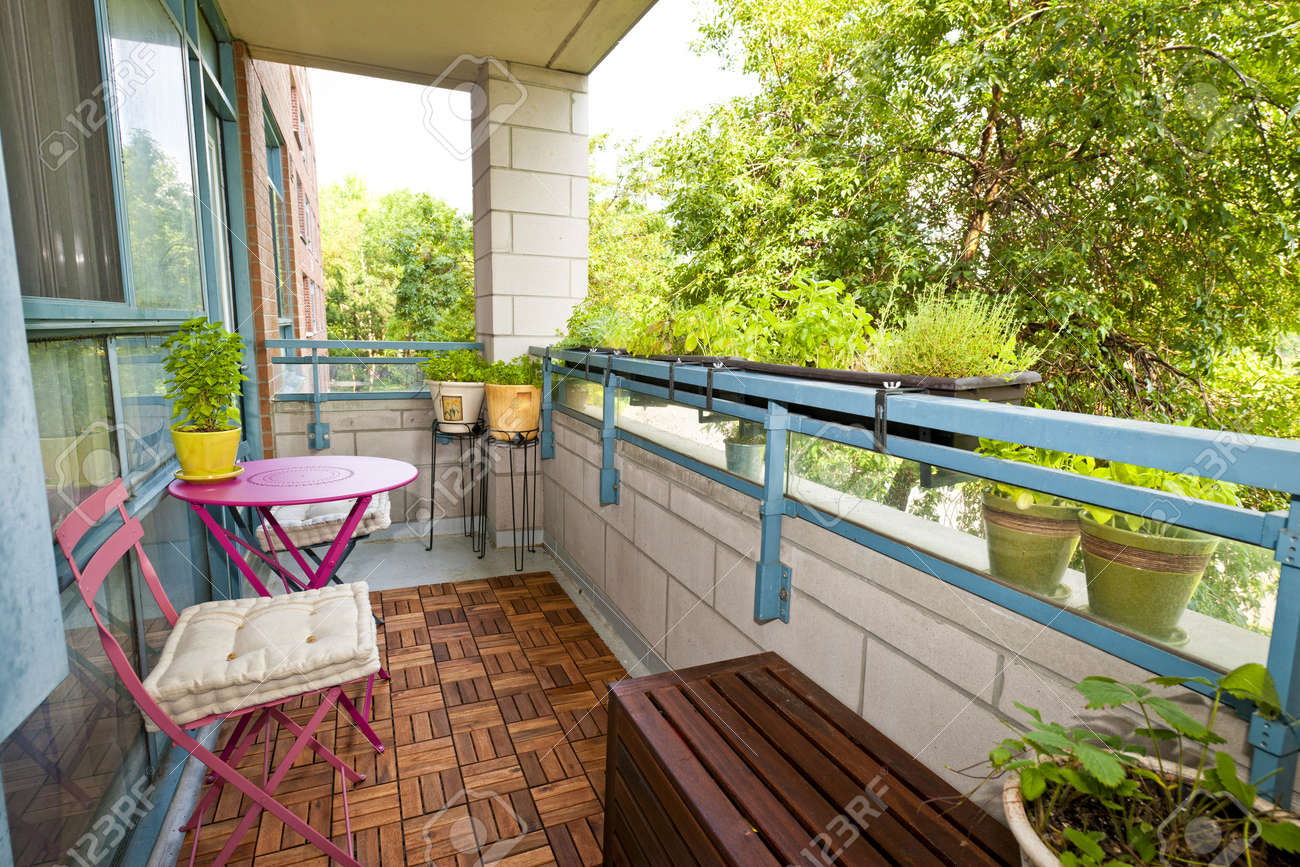 Balcony Of Condo With Patio Furniture And Plants Stock Photo