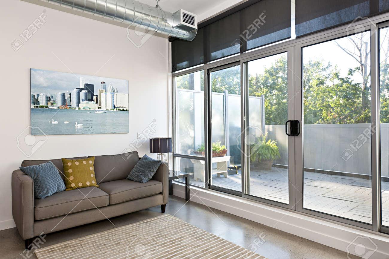Living room with sliding glass door to balcony artwork from photographer portfolio stock photo