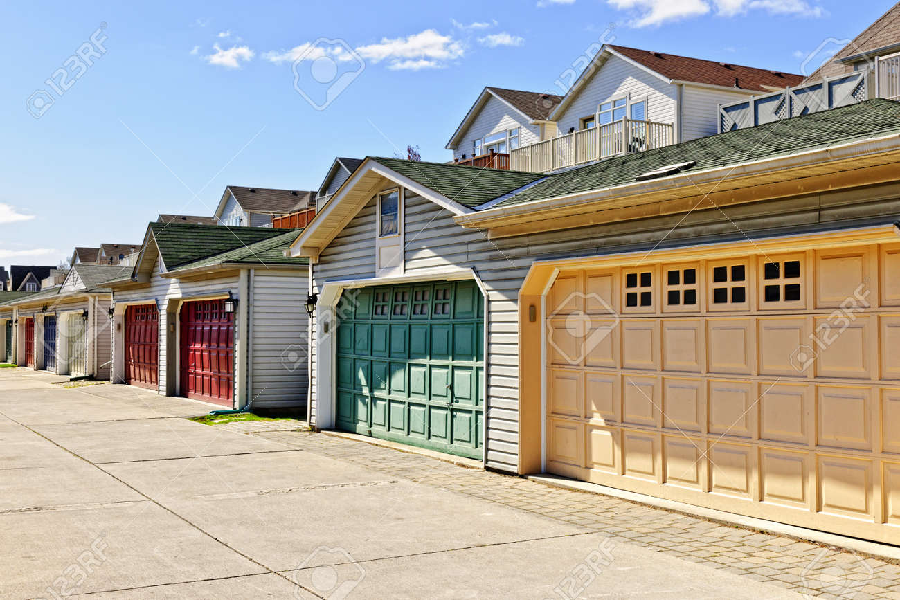 Row of garage doors at parking area for townhouses Stock Photo - 15391770