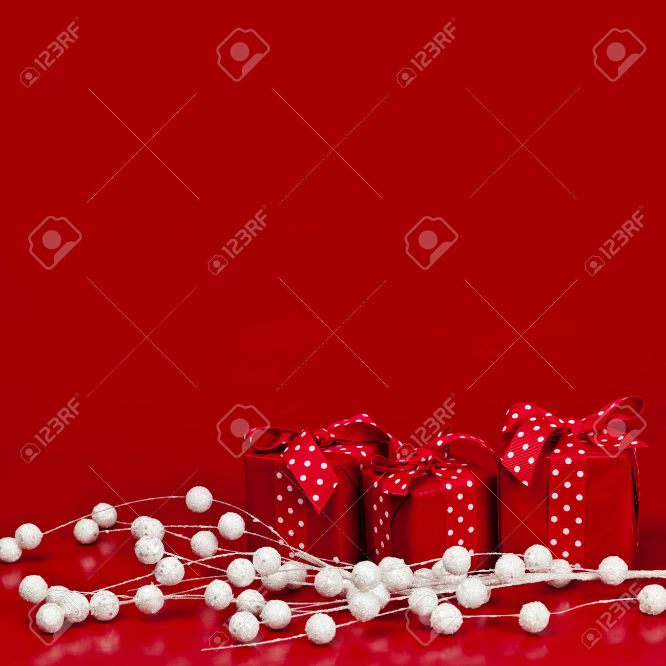 Red Christmas background with wrapped presents and decorations Stock Photo - 16654681