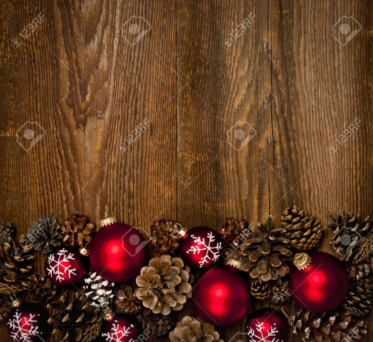Rustic Wood Background With Christmas Ornaments And Pine Cones Stock Photo