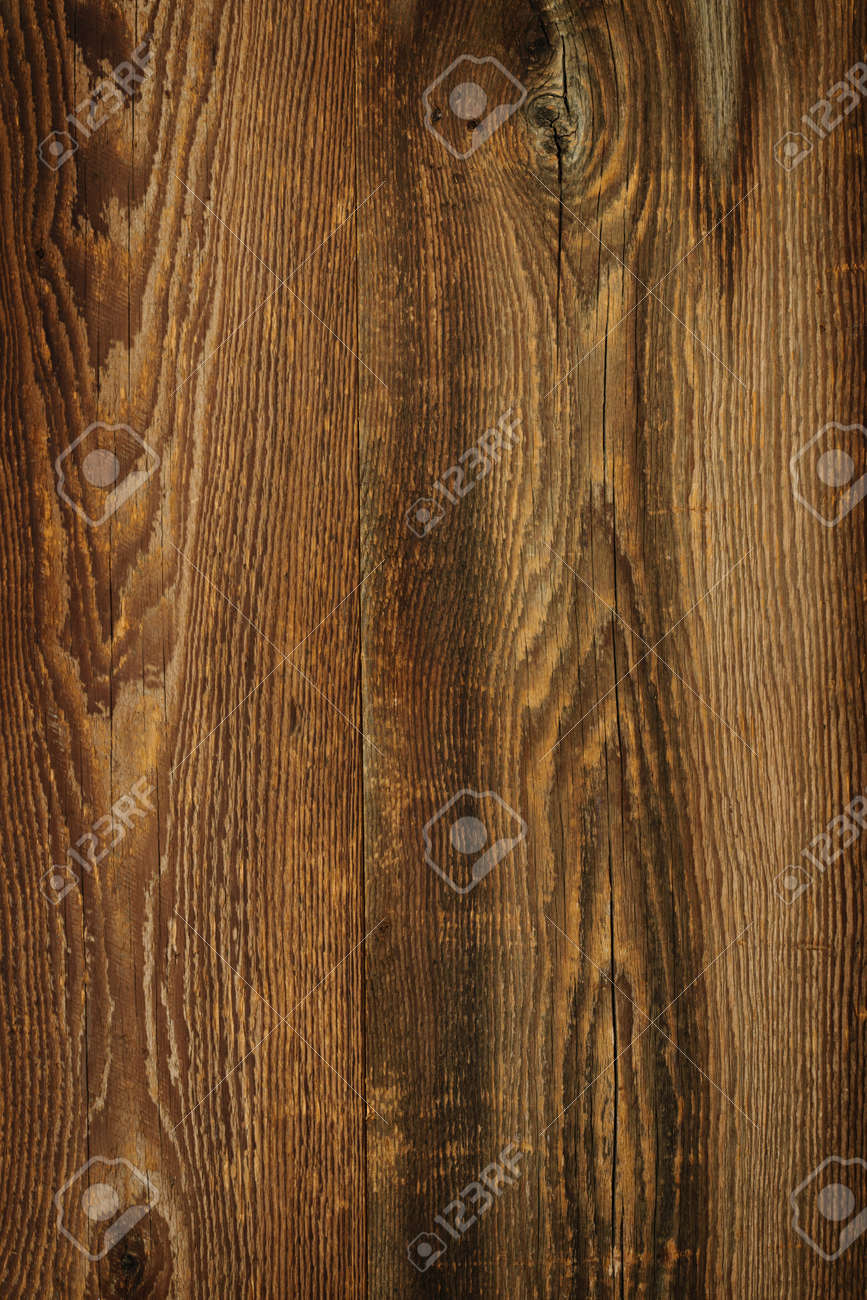 Brown rustic wood grain texture as background Stock Photo - 16654698