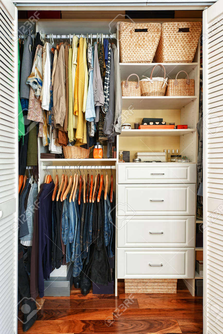 Clothes hung neatly in organized closet at home - 18049012
