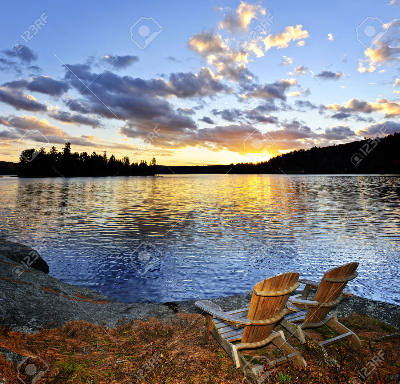 Beach sunset with chairs - Stock Photo Wooden Chair On Beach Of Relaxing Lake At Sunset In Algonquin Park Canada
