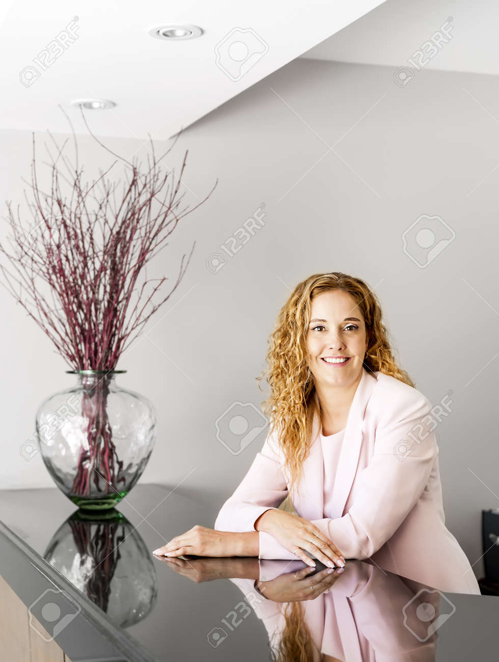 Receptionist standing at reception counter in office Stock Photo - 19535938