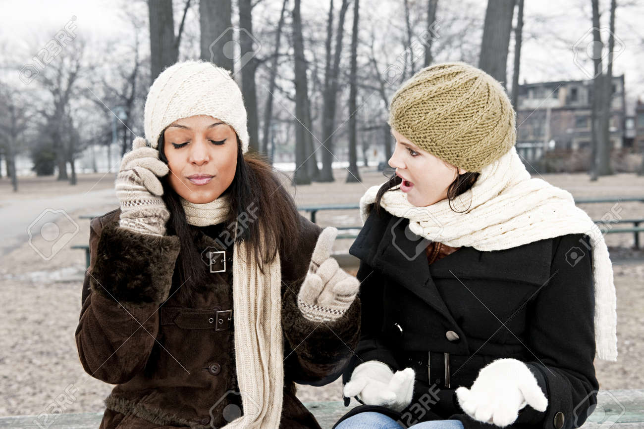 Woman shocked by friend ignoring her with phone call Stock Photo - 20785482
