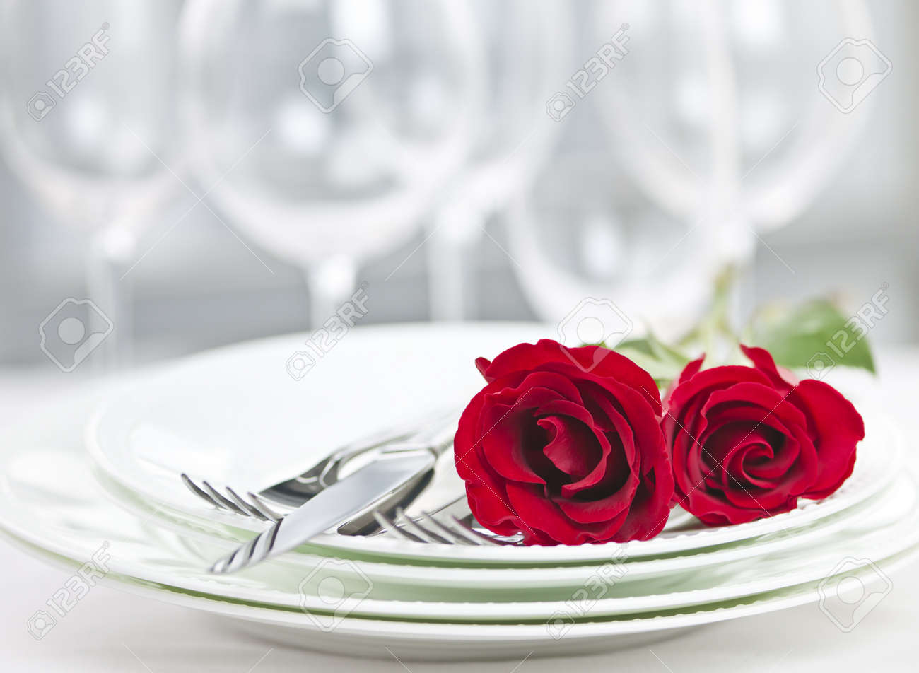 How to set a romantic dinner table for two - Romantic Restaurant Table Setting For Two With Roses Plates And Cutlery Stock Photo 21849983