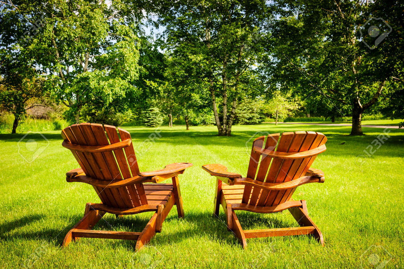 Colorful Adirondack Chairs - Adirondack chair two wooden adirondack chairs on lush green lawn with trees