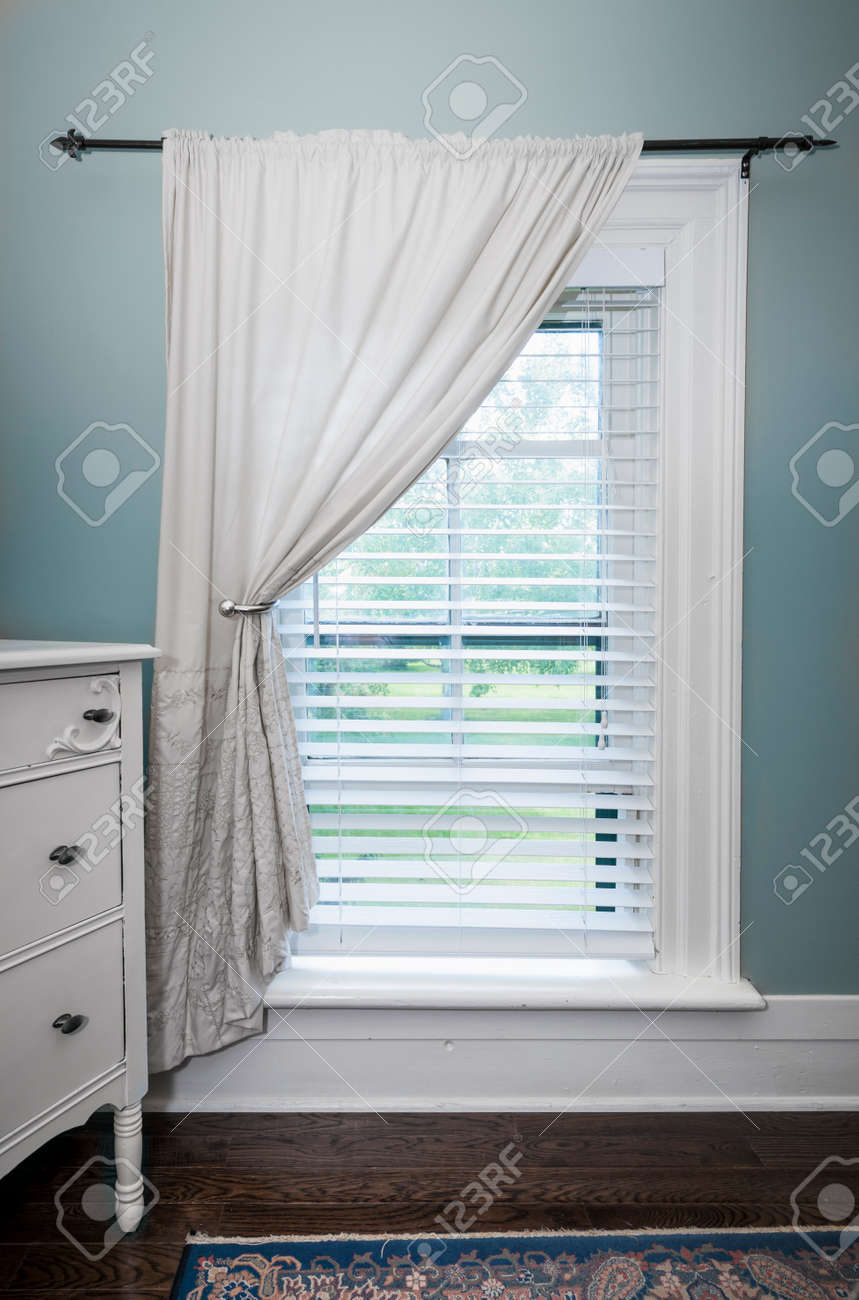 Stock Photo   Window With Venetian Blinds And White Curtain In Country  Style Room