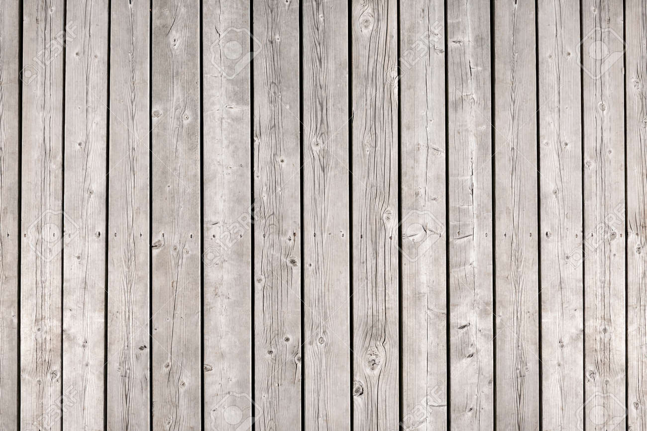 Background of old wooden weathered unpainted deck planks - 27768117