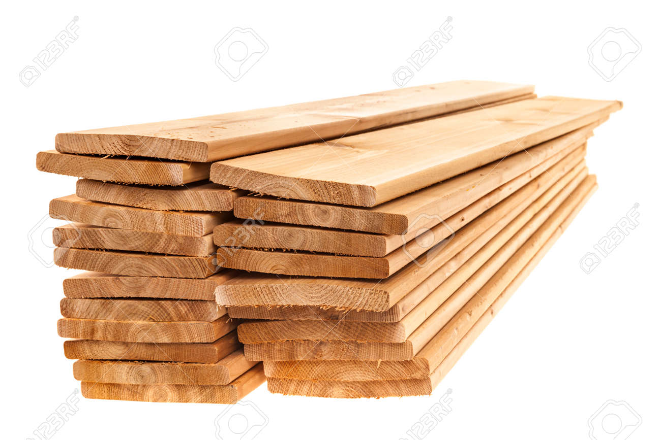 Stacks of cedar one by six inch wood planks on white background - 28917348