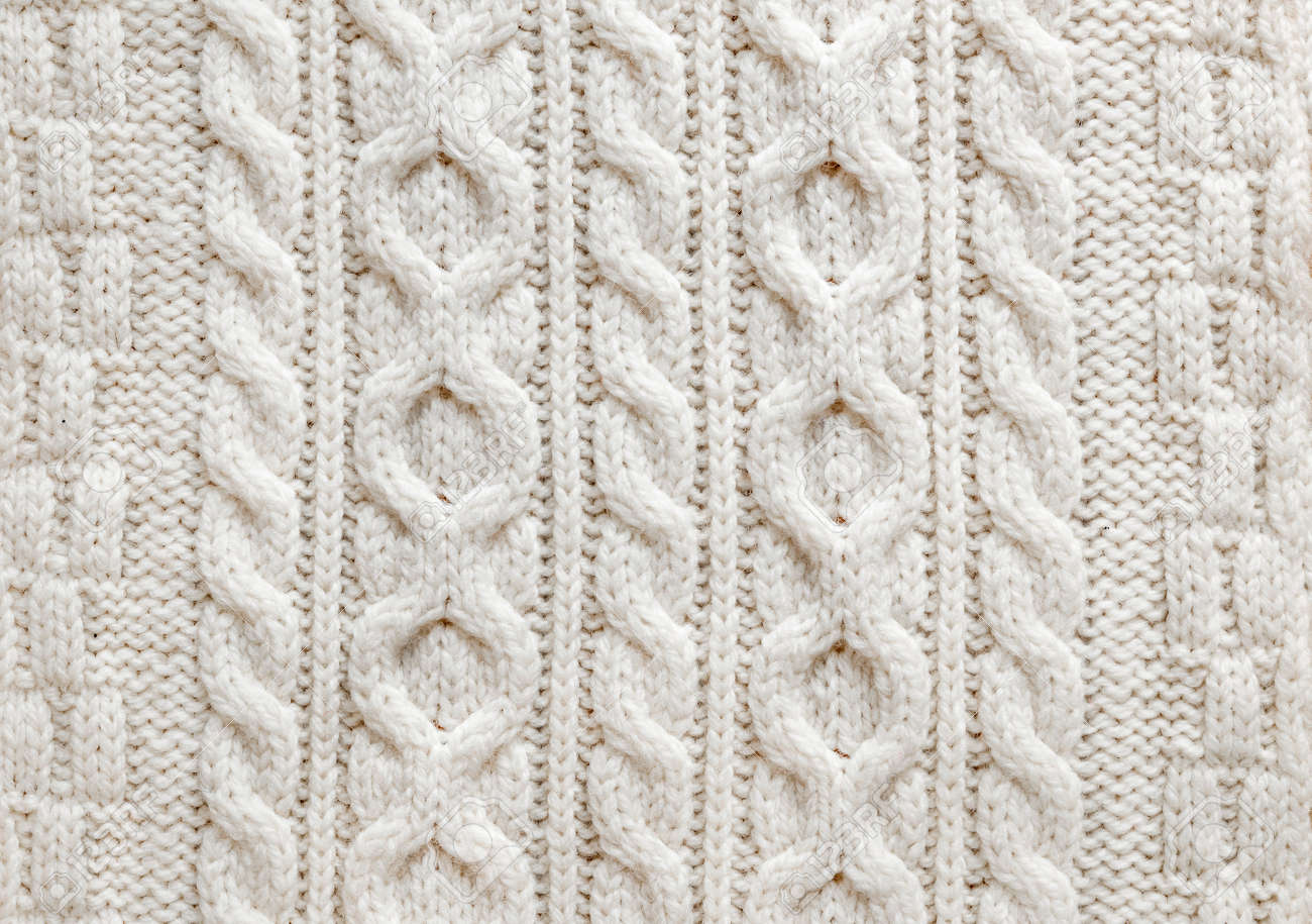 Knit texture of light natural wool knitted fabric with cable pattern as background - 30610296