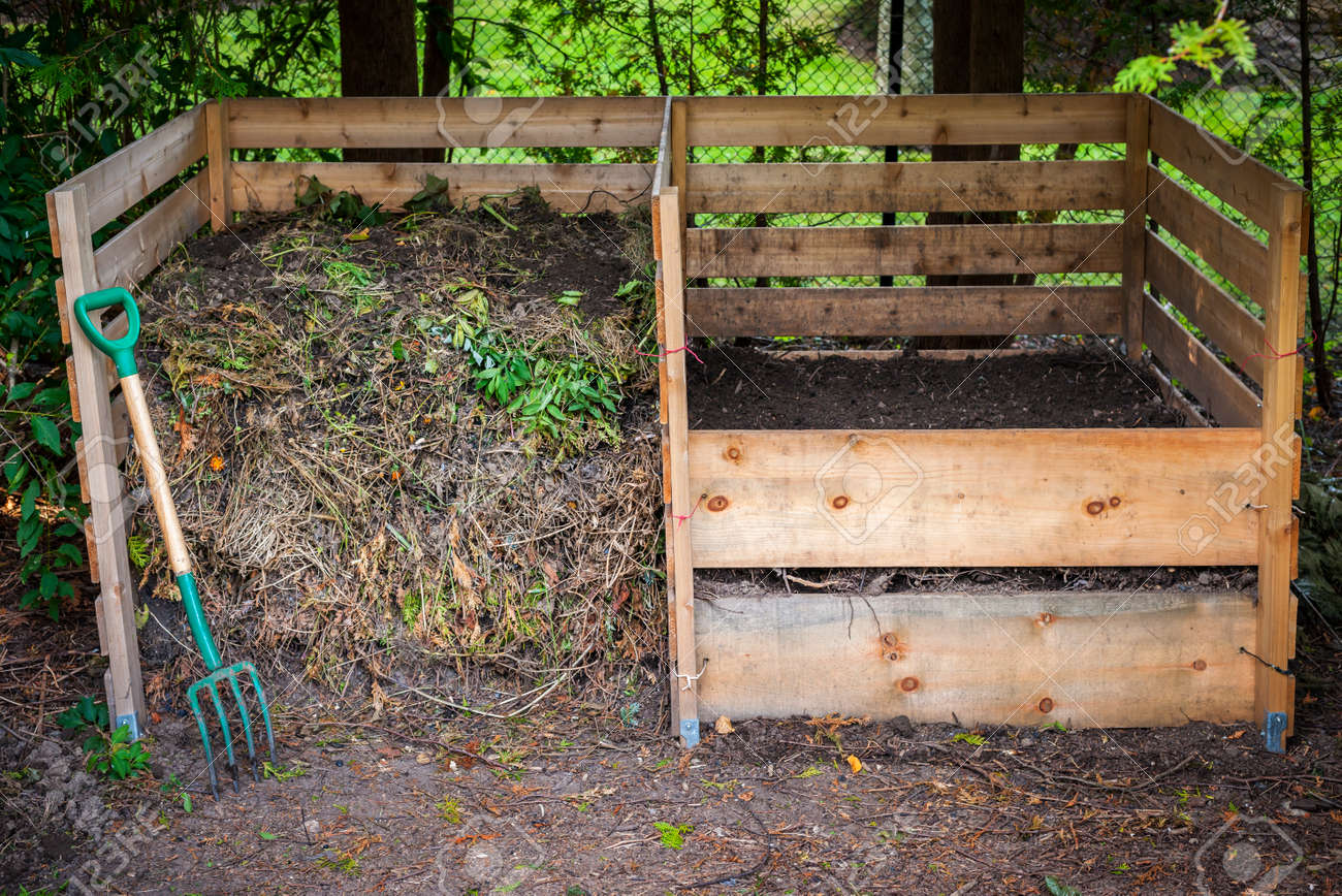 Large cedar wood compost boxes with composted soil and yard waste for backyard composting Stock Photo - 35887450
