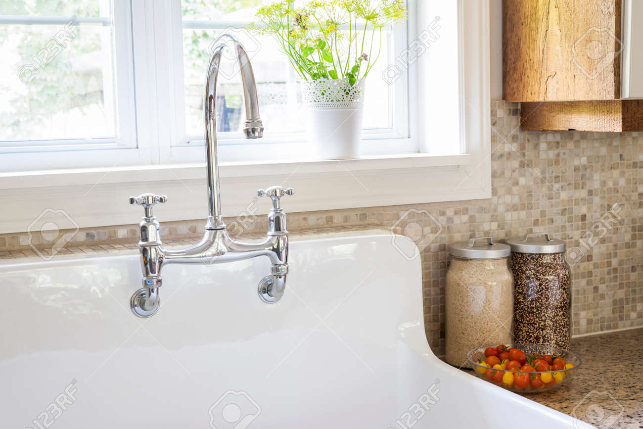 Rustic White Porcelain Kitchen Sink With Curved Faucet And Tile ...