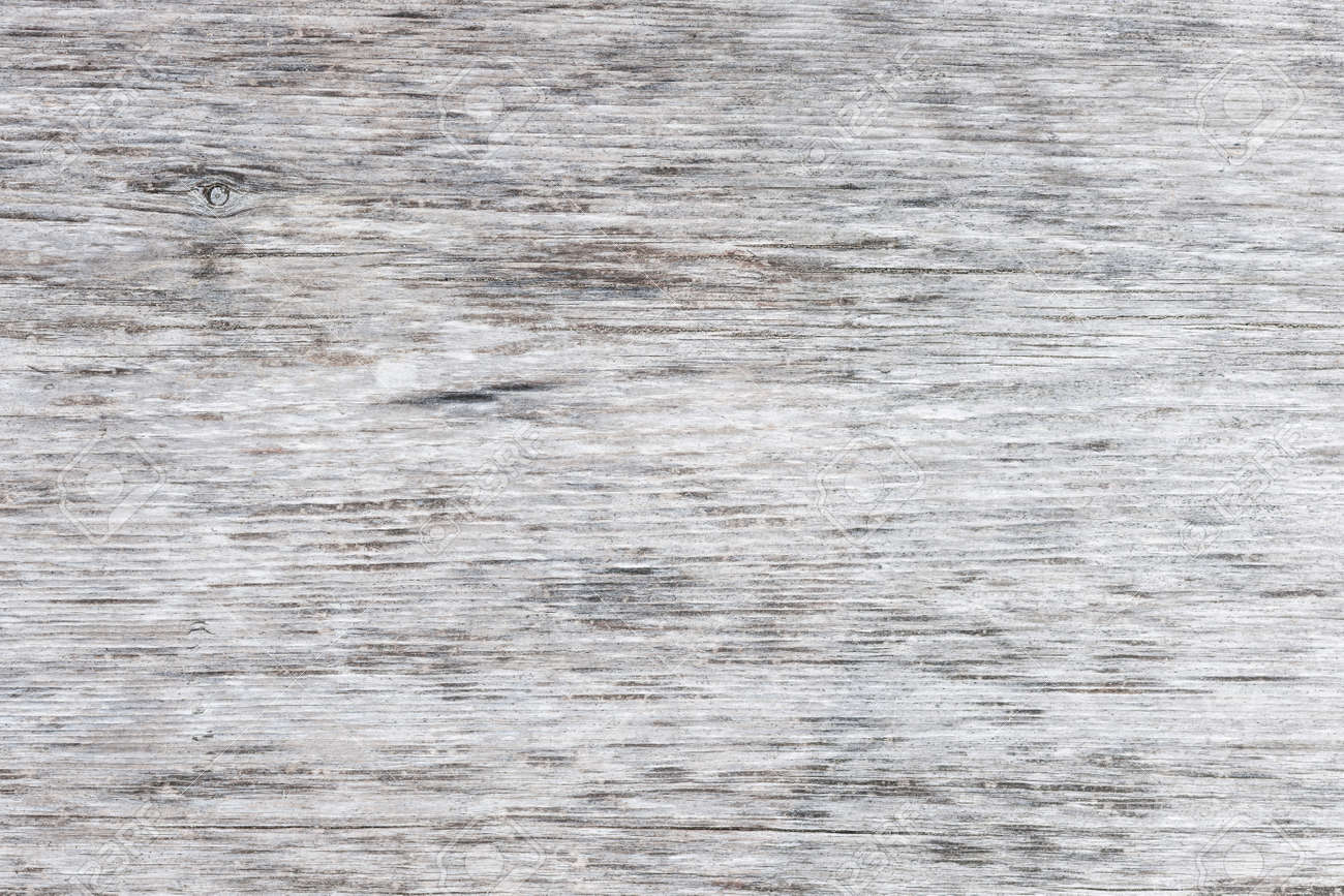 Gray wooden background of weathered distressed unpainted rustic wood showing woodgrain texture Stock Photo - 39541899