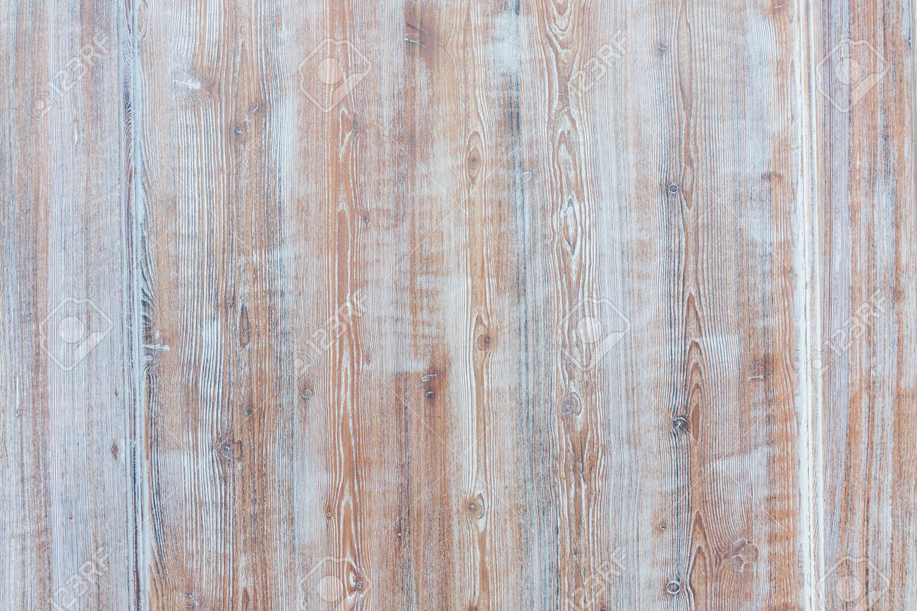 Aged wooden background of weathered distressed rustic wood boards with faded light blue paint showing brown woodgrain texture - 44351011