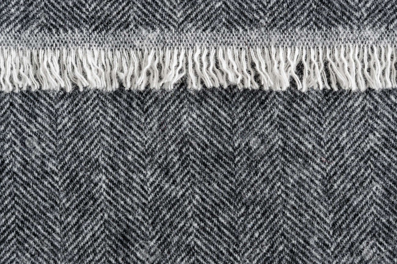Herringbone wool tweed fabric background with closeup on textile texture  and overlapping fringe edge Stock Photo 004f15d9e6c1