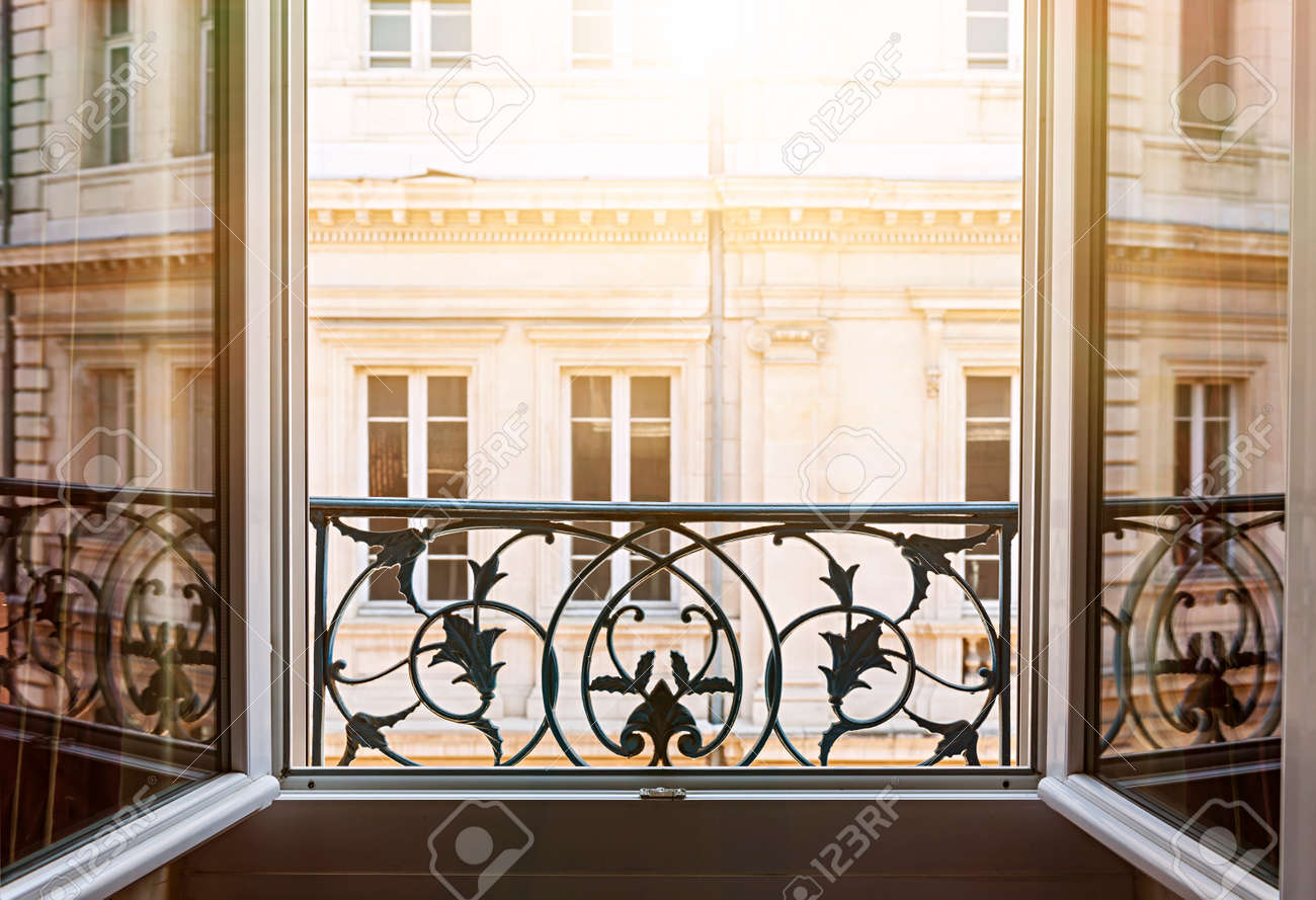 View of european building from an open window in Toulouse, France, with late afternoon sunshine. - 62917032