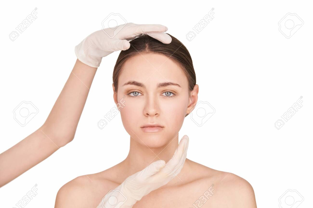 Beauty girl cosmetology test. Doctor gloves. Cosmetology clinic treatment. Woman face therapy. Plastic opeartion prepare. Facial procedure. White isolated background - 152554776