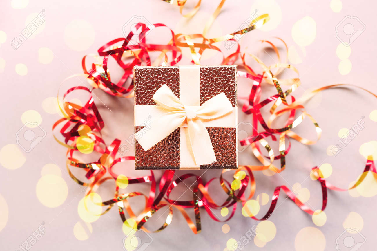 Christmas gift box with festive ribbons and golden stars - 159819714