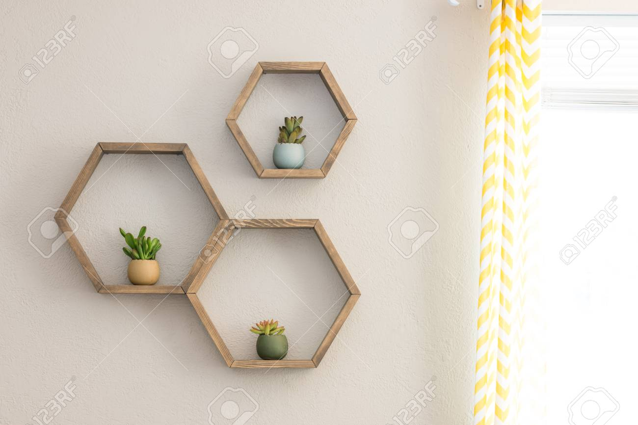 Three decorative wooden, floating, hexagon wall shelves, with decorative plants - 104202321