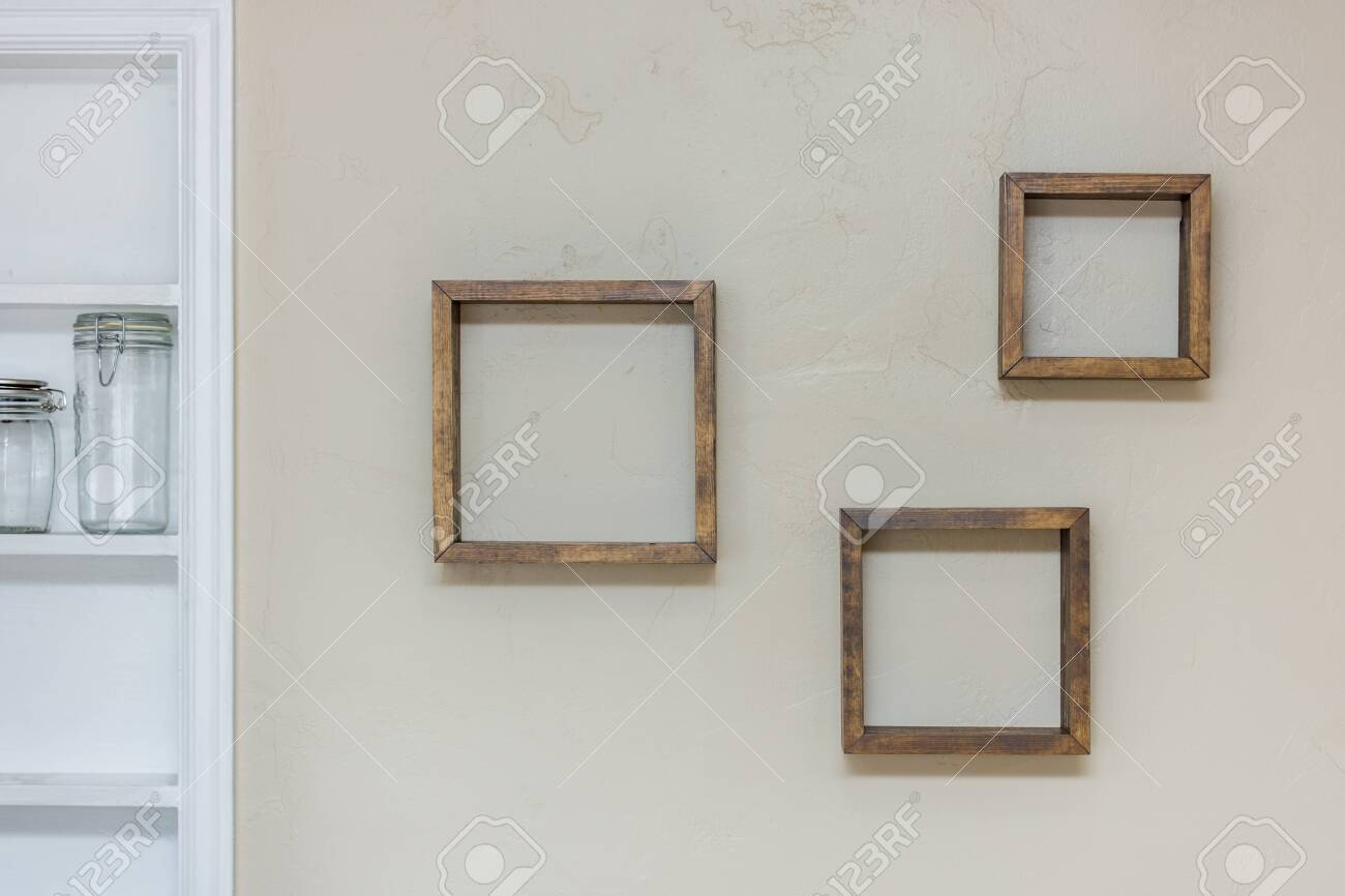 photo square shaped floating shelves empty on wall