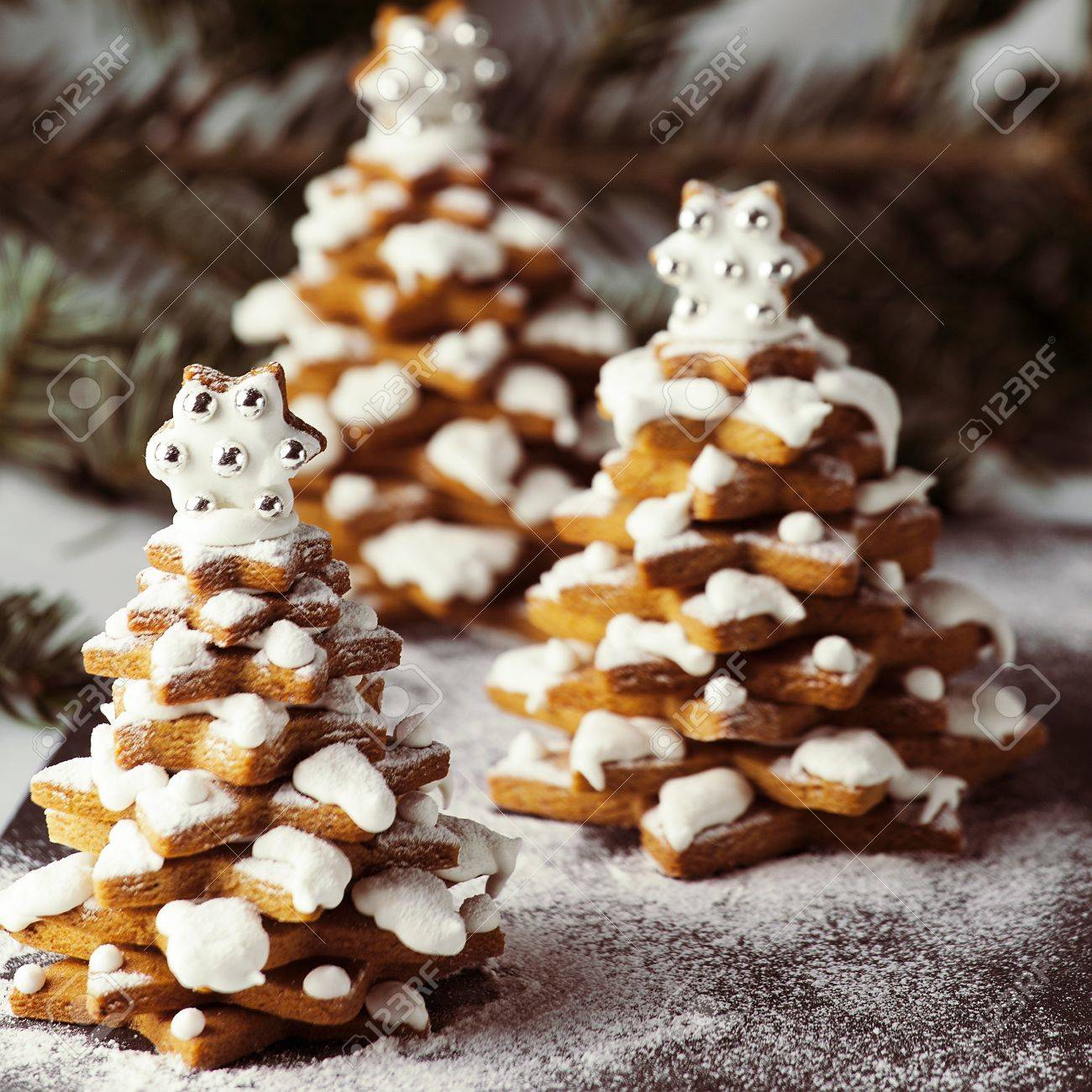 gingerbread christmas trees cookies with live christmas tree branch and decoration 49373285 - Gingerbread Christmas Tree