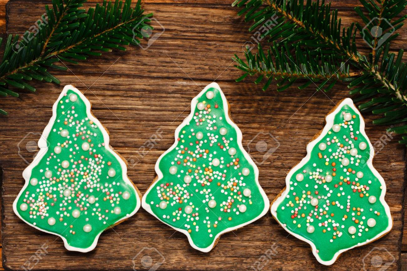 Gingerbread Christmas Tree Cookies With Fir S Branch On The Wooden