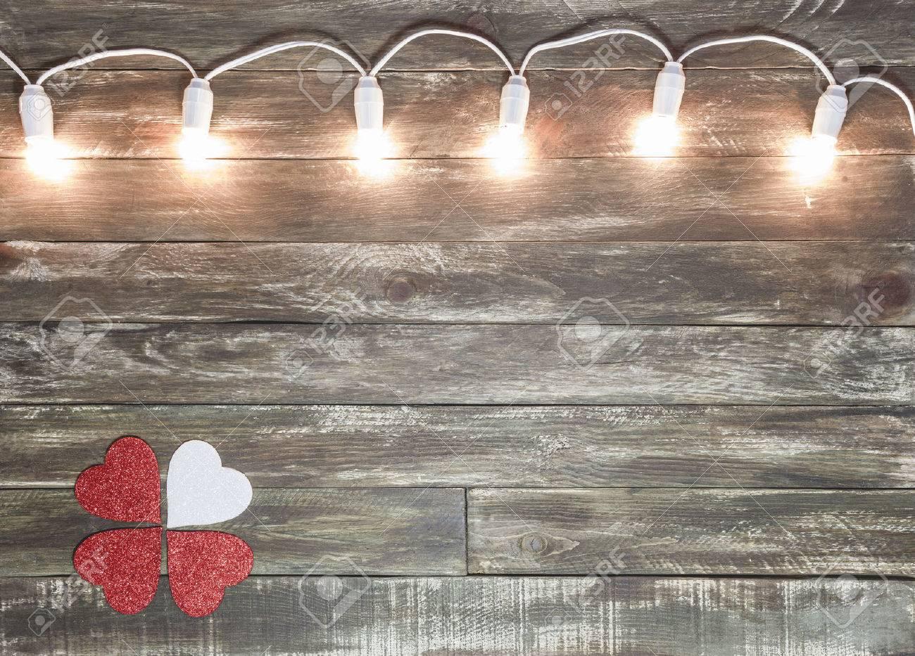 saint valentine wooden textured background with light garland - 68053077