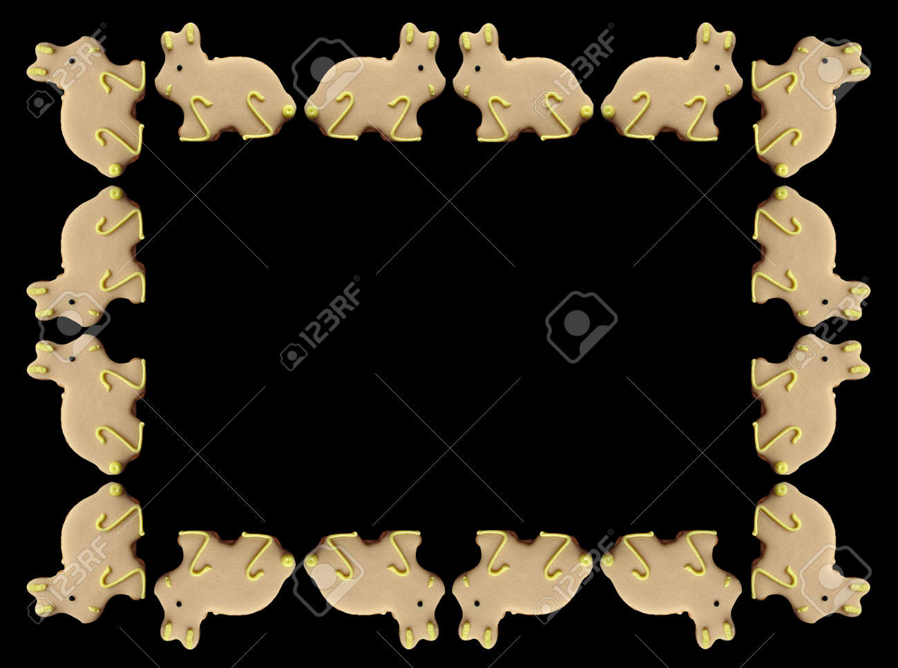 A frame of Easter cookies isolated on a black background. Stock Photo - 3569985