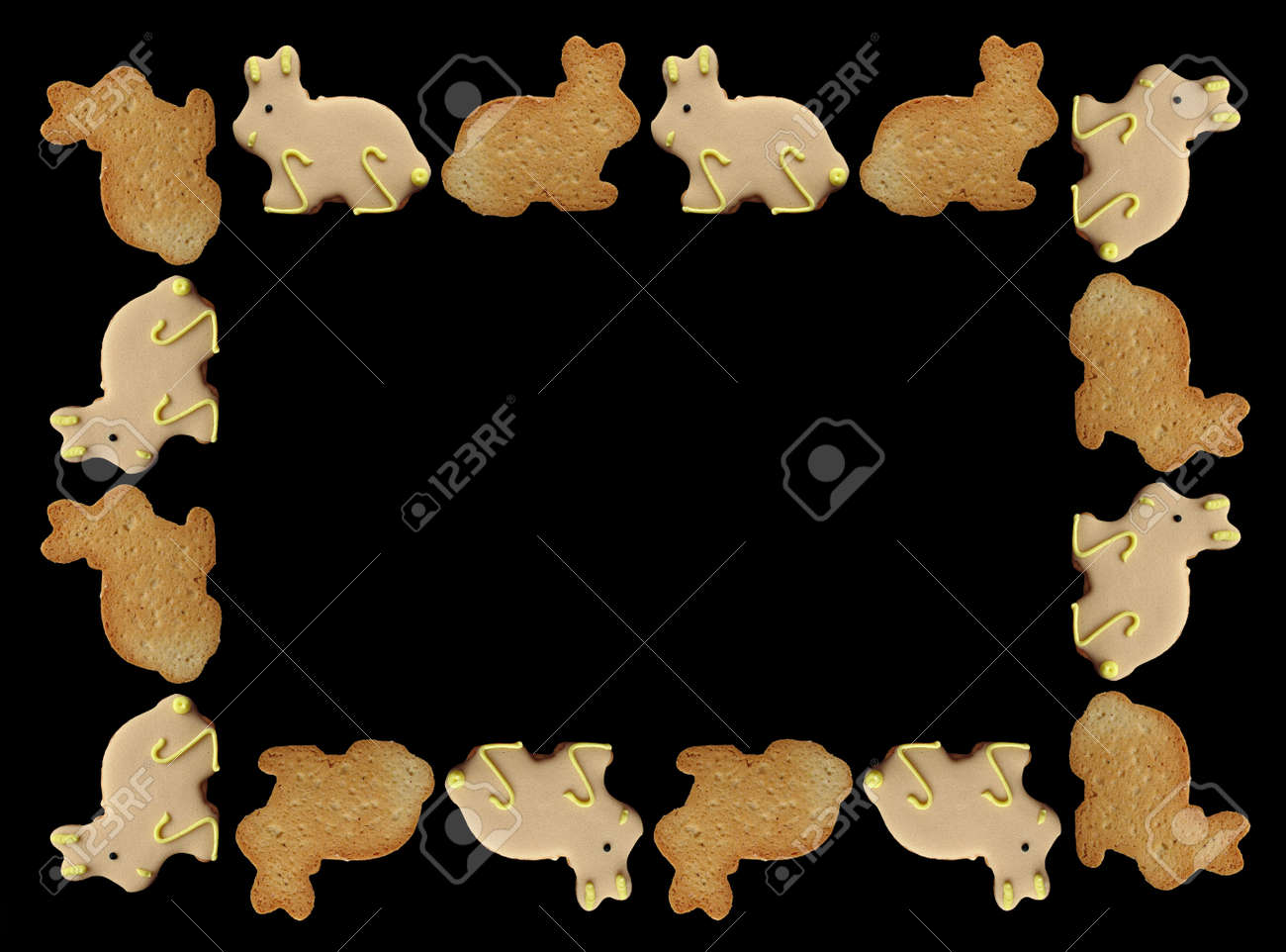 A frame of Easter cookies isolated on a black background. Stock Photo - 4672138
