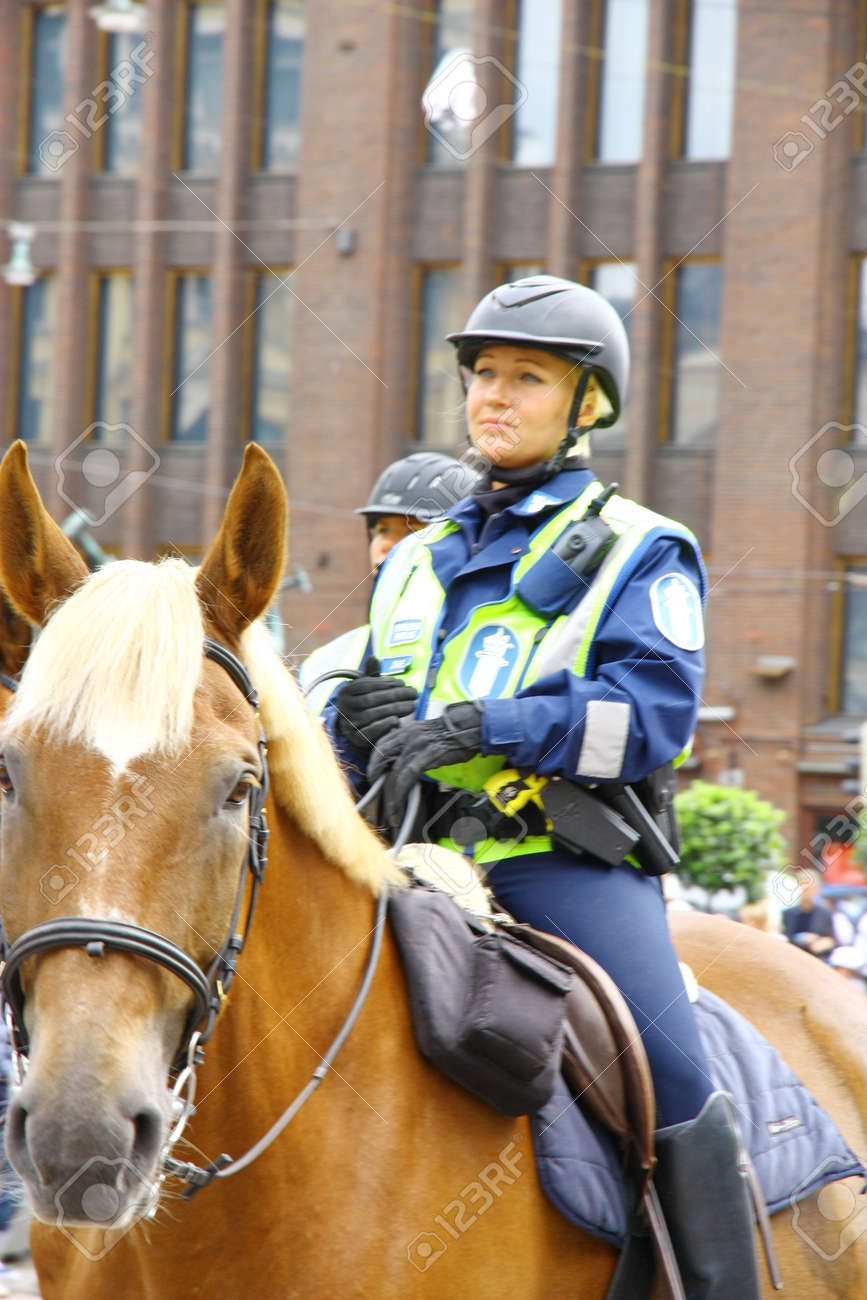 HELSINKI, FINLAND - JUNE 30: Mounted police protect people taking part in the annual Helsinki Pride gay parade in Helsinki, Finland on June 30, 2012.  Stock Photo - 17436306