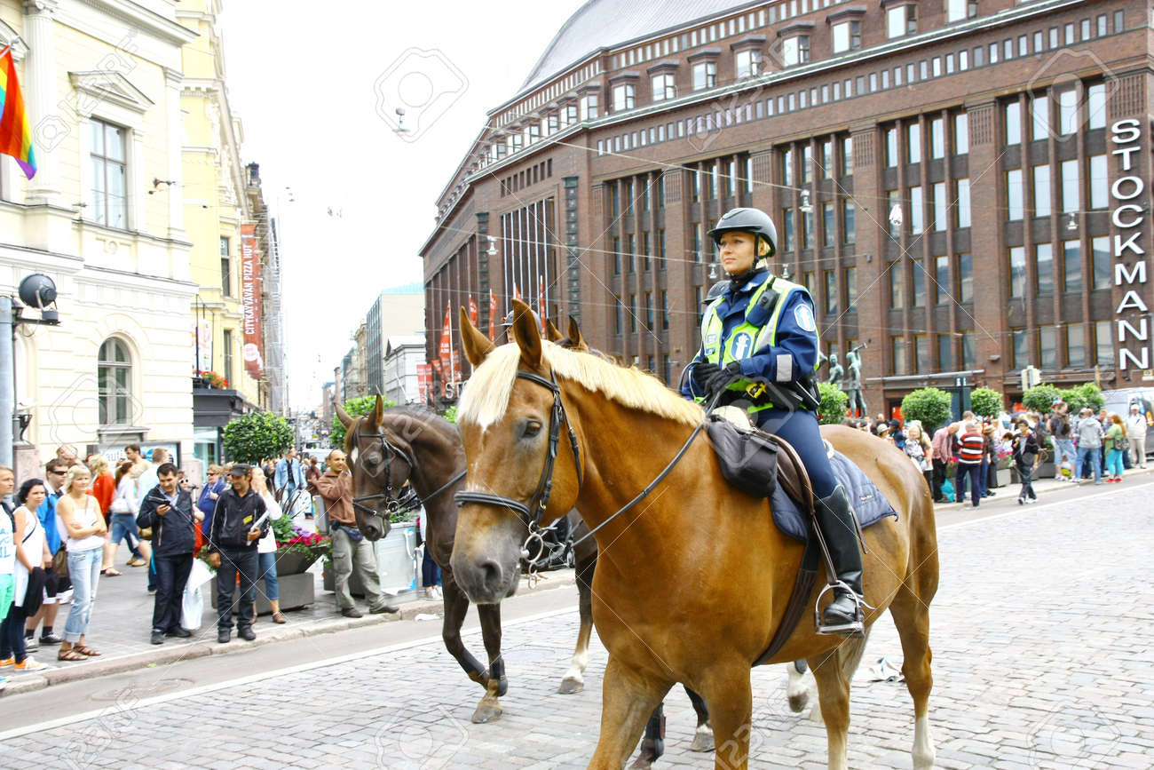 HELSINKI, FINLAND - JUNE 30: Mounted police protect people taking part in the annual Helsinki Pride gay parade in Helsinki, Finland on June 30, 2012.  Stock Photo - 17436468
