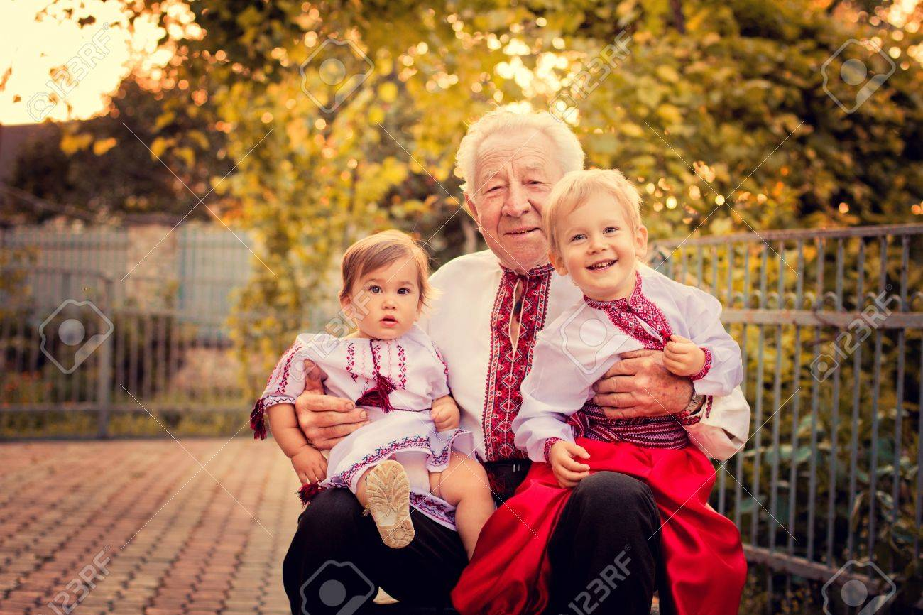 A portrait of a grandfather and grandchildren at the yard Stock Photo - 16540156