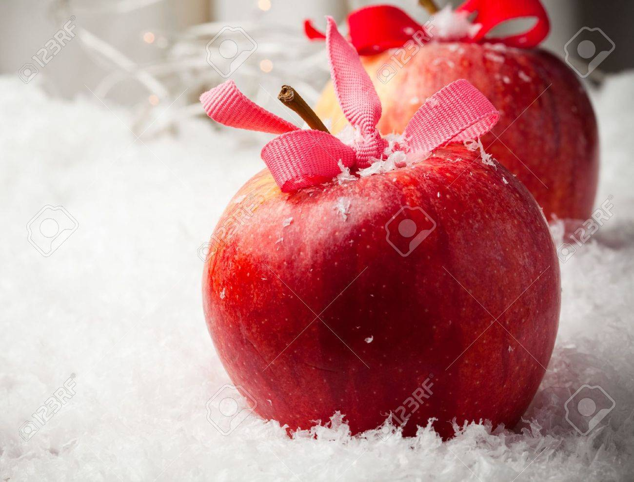Red delicious Christmas apples resting in snow - 7947501