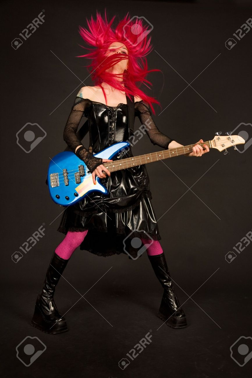 Rock girl with bass guitar shaking her head Stock Photo - 3018835