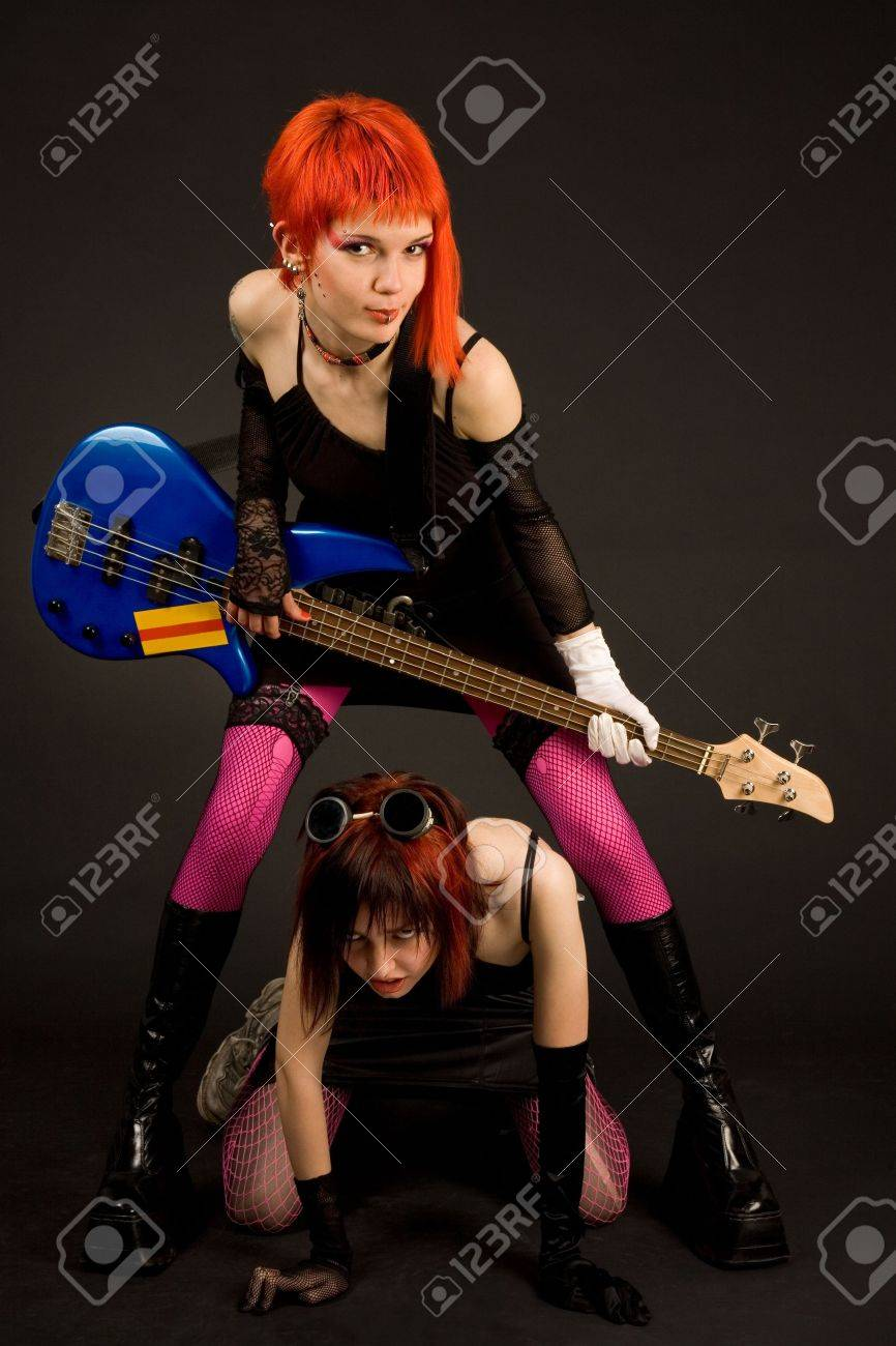 Rock girls with guitar isolated in studio Stock Photo - 3037905