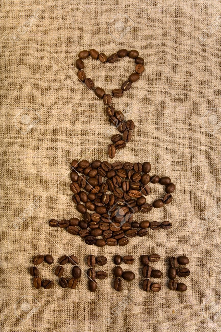 Coffee cup with heart made of beans over canvas background Stock Photo - 4801862